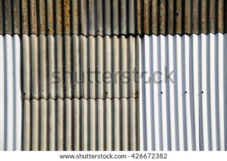 Distressed old rusty corrugated iron fence background - stock photo