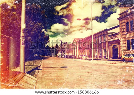 Distressed vintage grungy photo of a street in Cuenca, Ecuador - stock photo