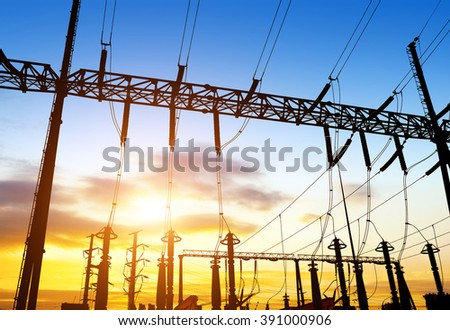 distribution electric substation with power lines and transformers, at sunset - stock photo
