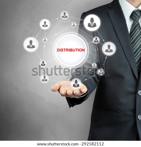 DISTRIBUTION sign with people icon network on businessman hand - stock photo