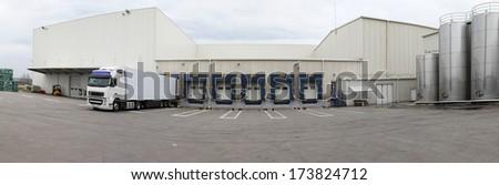 Distribution warehouse and logistics center panorama - stock photo