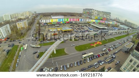 District with crossroads of highways and railway with electric train near the telecentre, view from unmanned quadrocopter. - stock photo