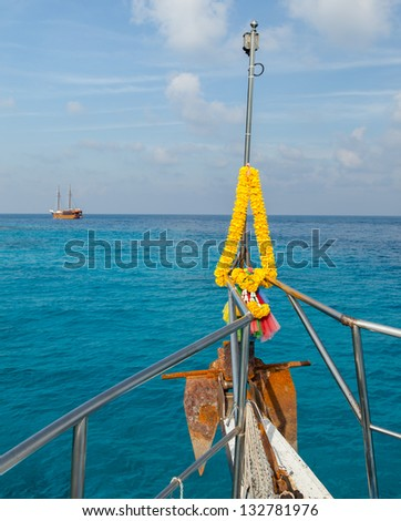 Dive boat at similian Islands, Thailand. Flower decorated bow. - stock photo