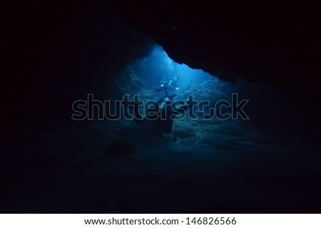 dive into cave - stock photo