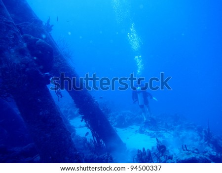 diver at a wreck - stock photo