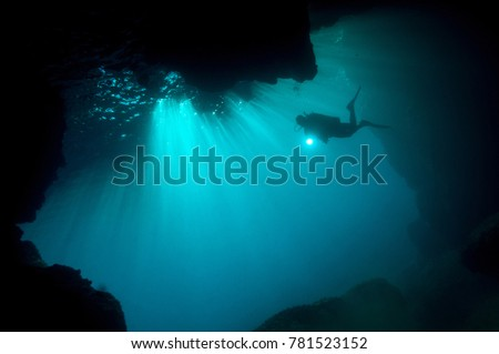 Diver at the entrance of a marine cave, Fethiye Turkey