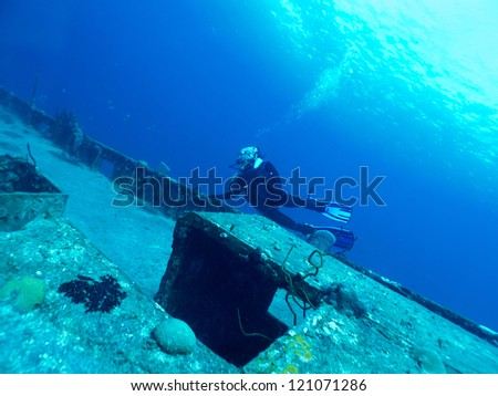 diver exploring a wrack - stock photo