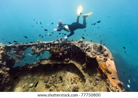 Diver exploring shipwreck underwater. Gunboat at Lusong Island - stock photo