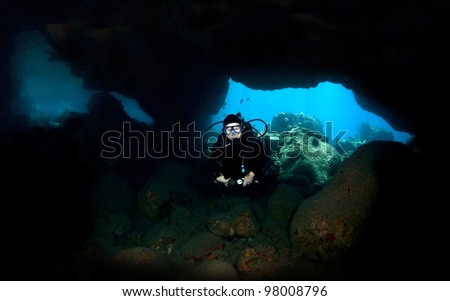 Diver in Lava Tube in Kona Hawaii close up - stock photo