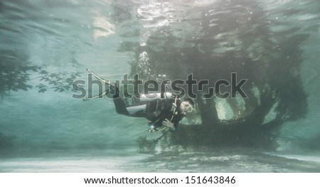 diver in swimming pool - stock photo