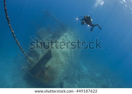 Diver over the Cedar Pride Wreck in Aqaba Jordan