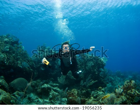 Diver smiling underwater on a Caribbean Reef - stock photo