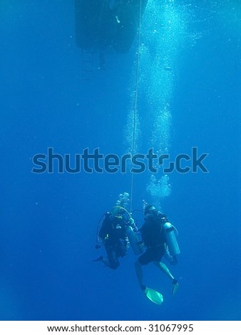 Divers at the decompression stop after extreme dive - stock photo