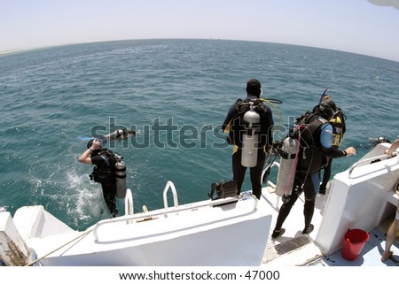 Divers entering water - stock photo