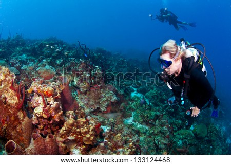 Divers on a reef on St Lucia with a Photographer