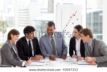 Diverse business group sitting around a conference table in a meeting