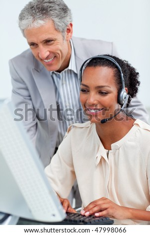 Diverse business partners working at a computer in the office - stock photo