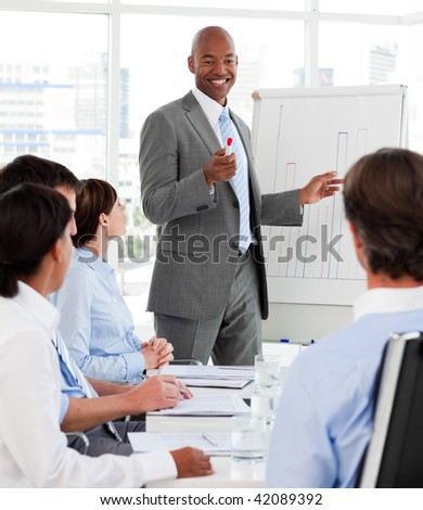 Diverse business people studying a new business plan in the office - stock photo
