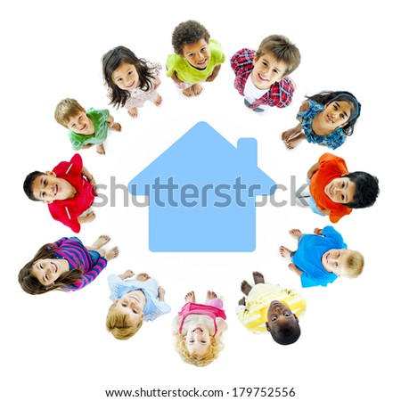 Diverse Children Standing in Circle Around Home Symbol - stock photo