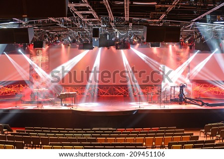 Diverse concert lights on stage with musical instruments - stock photo