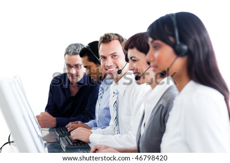 Diverse customer service representatives with headset on in a call center