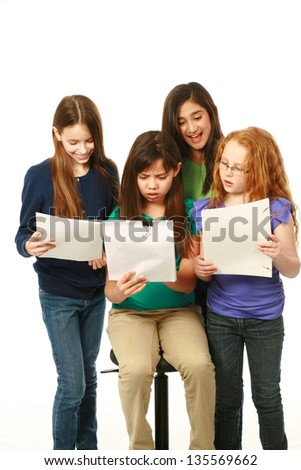 diverse girls reading scripts and having fun