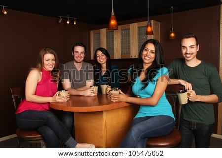 Diverse Group of Friends at the Cafe - stock photo