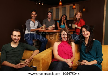 Diverse Group of Friends at the Coffee Shop - stock photo