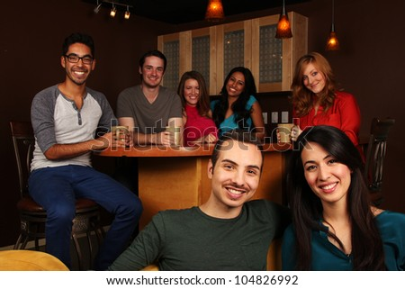 Diverse Group of Friends in Cafe - stock photo