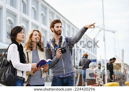 diverse group of friends traveling together having fun - stock photo