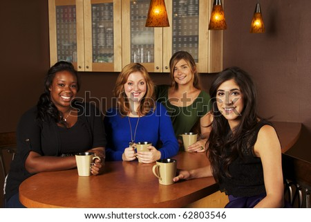 Diverse group of Girlfriends at a Cafe - stock photo