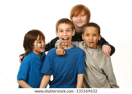 diverse group of happy boys on white background - stock photo