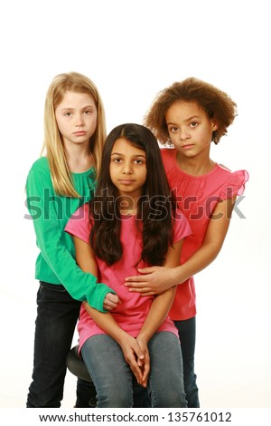 diverse group of sad preteen girls