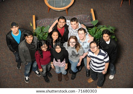 Diverse Group of Students smiling taken from a high point of view - stock photo