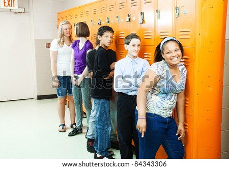 Diverse group of teenage students at their school lockers between classes. - stock photo