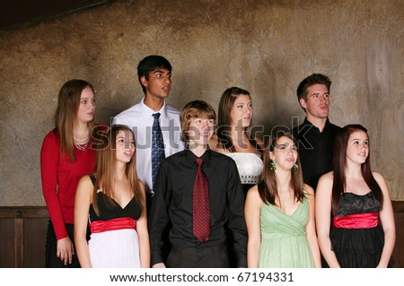 diverse group of teens singing and performing in choir in formal dress - stock photo