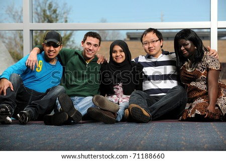 Diverse group of young people smiling - stock photo