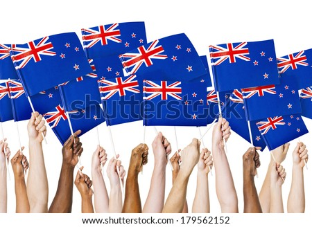Diverse Hands Holding Flags of New Zealand - stock photo
