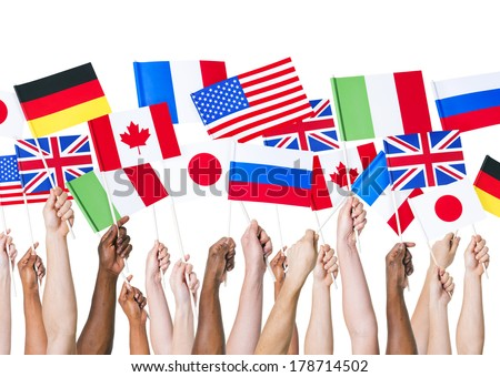 Diverse Hands Holding International Flags - stock photo