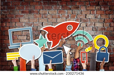 Diverse Hands Holding Technology Symbols - stock photo