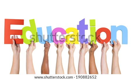 Diverse Hands Holding The Word Education - stock photo