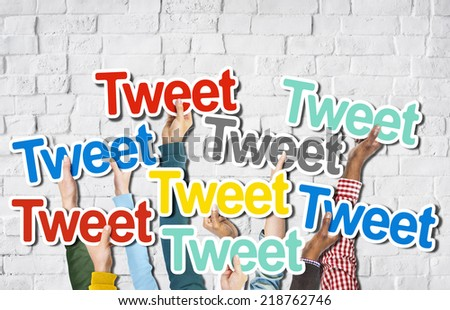 Diverse Hands Holding the Word Tweet - stock photo