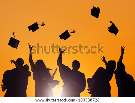 Diverse International Students Celebrating Graduation - stock photo