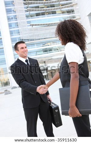 Diverse Man and Woman Business Team shaking hands at office building