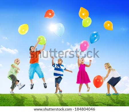 Diverse Multi-Ethnic Children Playing With Balloons Together - stock photo
