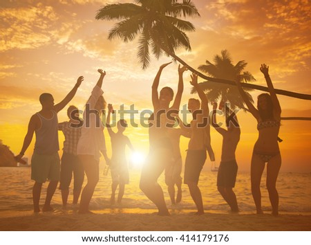 Diverse People Dancing and Partying on a Tropical Beach