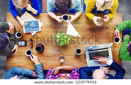 Diverse People Using Technologies and Talking - stock photo