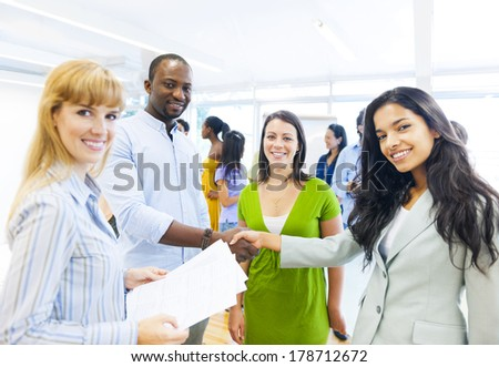 Diverse Smiling People Shaking Hands - stock photo