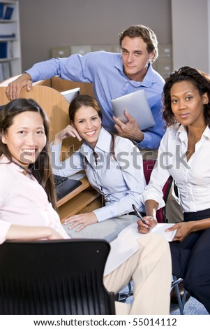 Diverse university students at library computer studying - stock photo