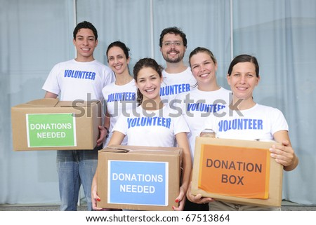 diverse volunteer group with food donation boxes - stock photo